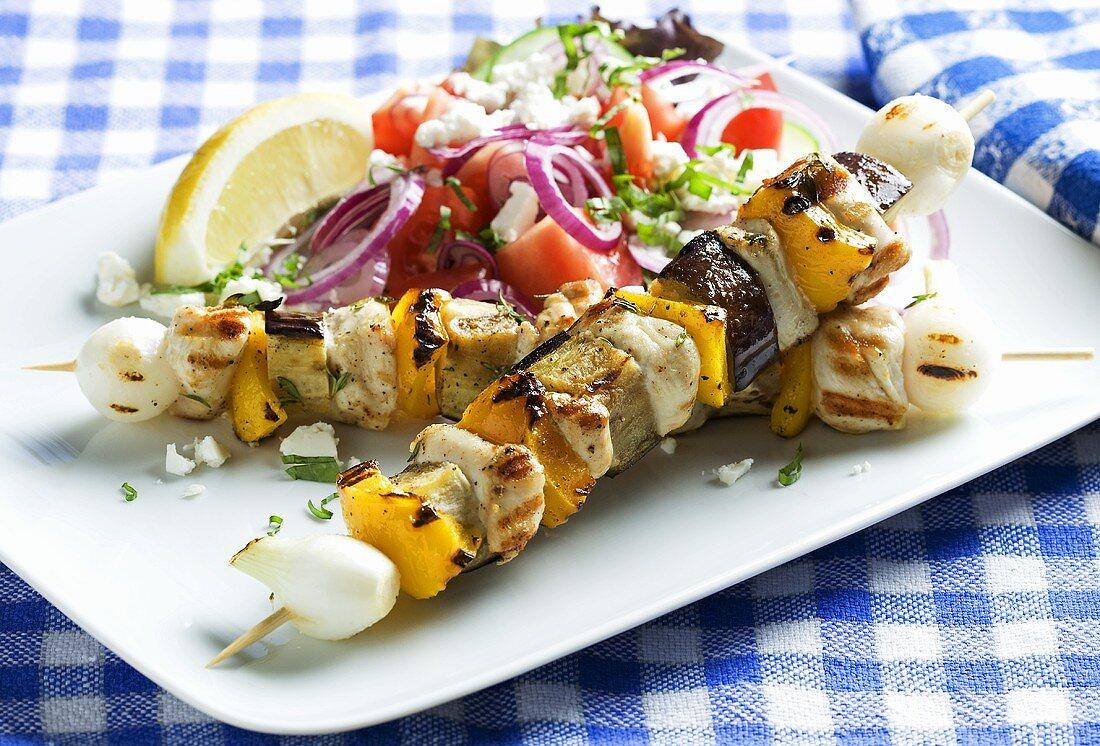 Chicken kebabs with Greek salad