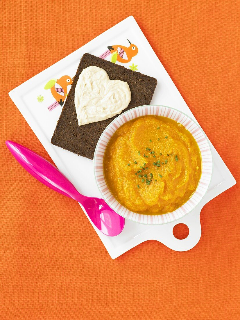 Bowl of Carrot Ginger Soup; Pumpernickel Bread with Hummus