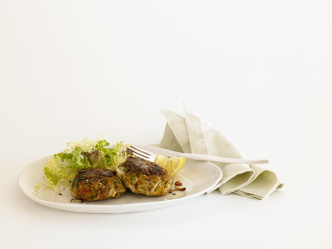 Crab Cakes with Side Salad on a Plate; Cloth Napkin