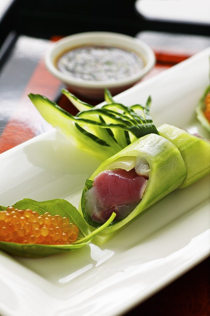 Cucumber rolls with tuna fish and char caviar with a wasabi dip (Asia)