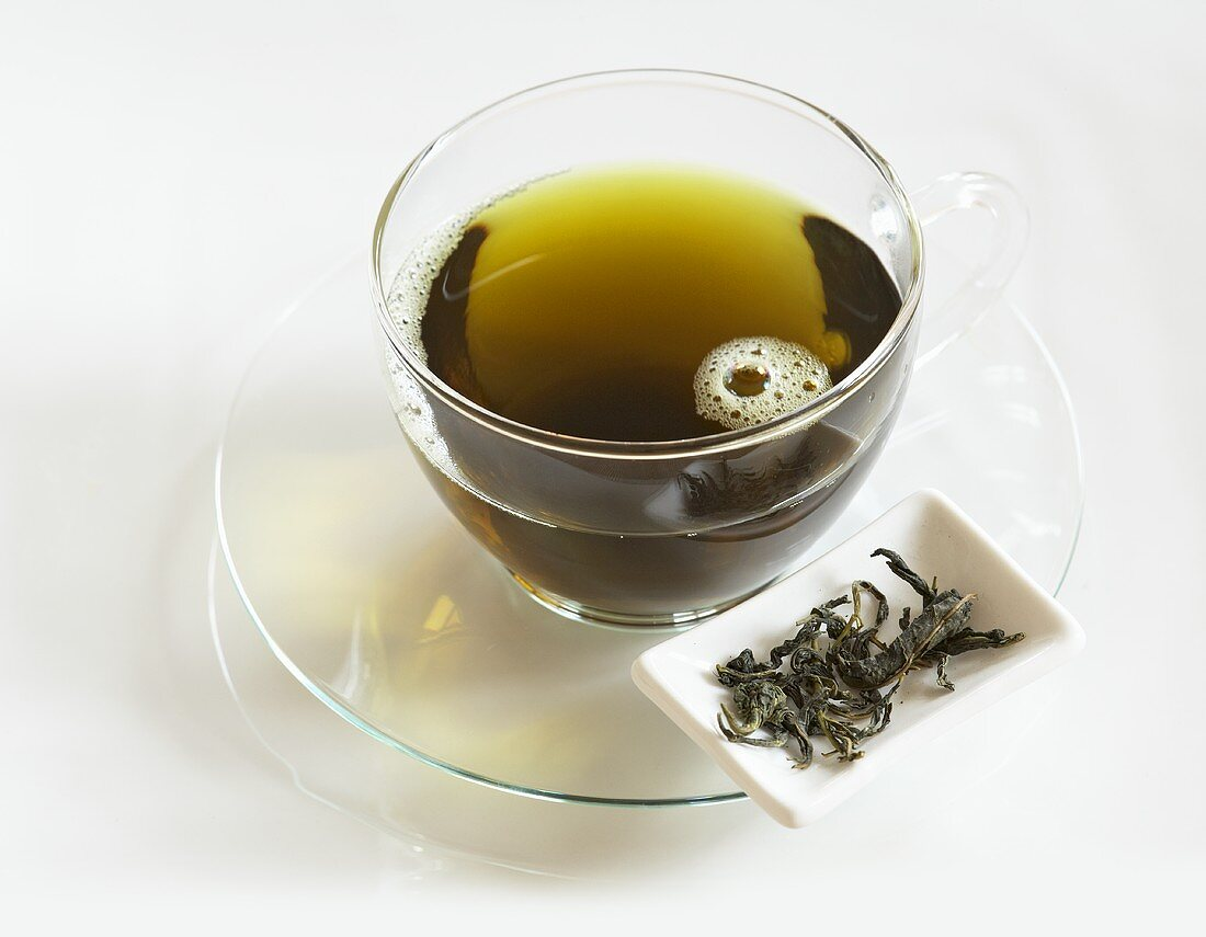 Mulberry tea in a glass cup