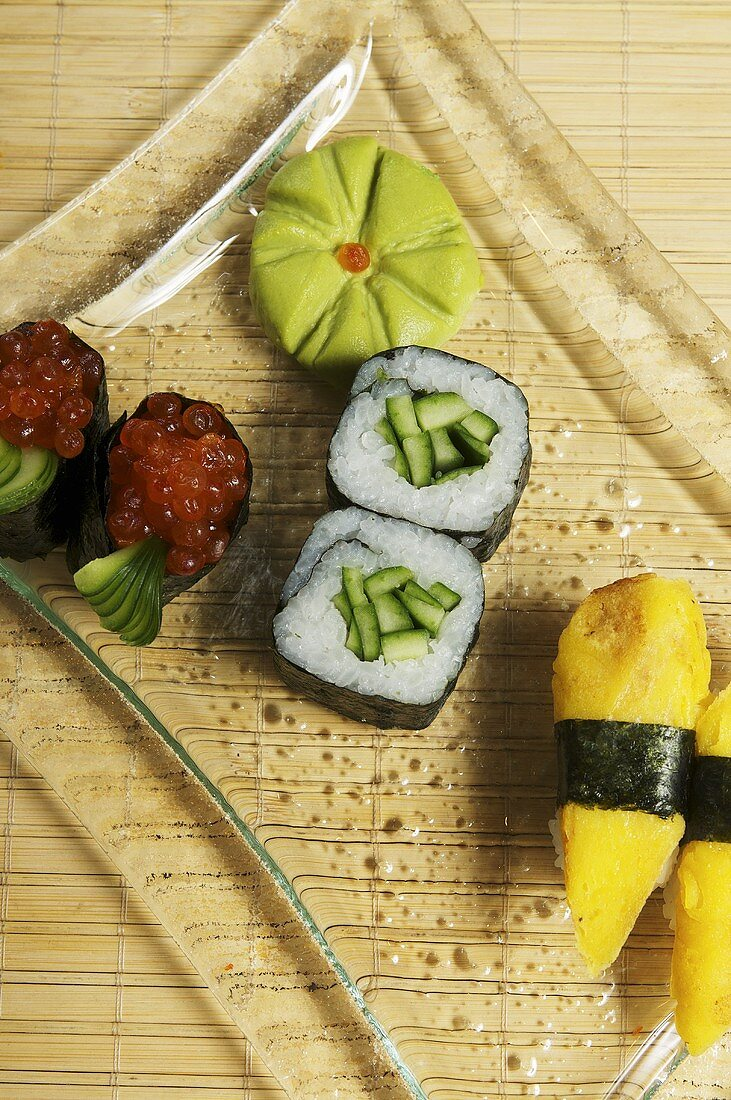 A sushi platter (maki with cucumber and salmon caviar, nigiri with royale)