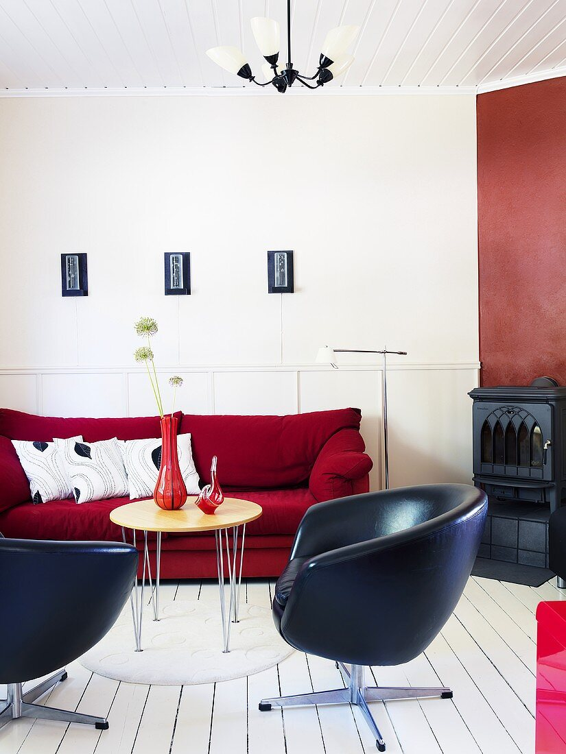 Living room with swivel chair and fireplace