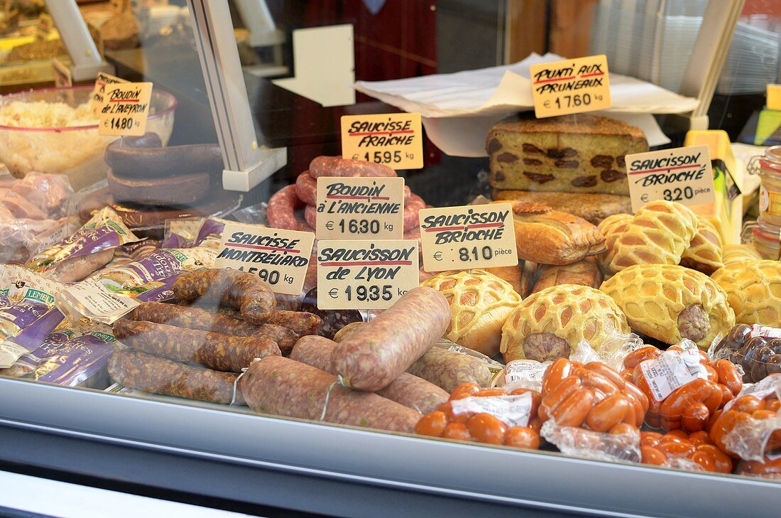 Sausage and cheeses in a grocery store display window