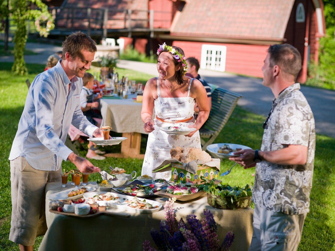 People at a buffet at a mid-summer party in Sweden