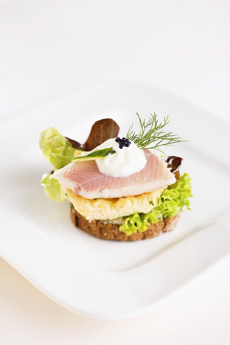 A canape with trout and scrambled egg