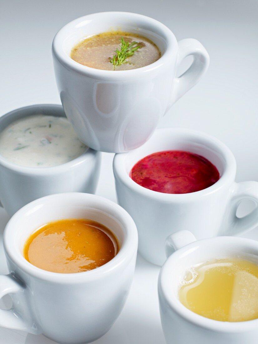 Various soups in espresso cups