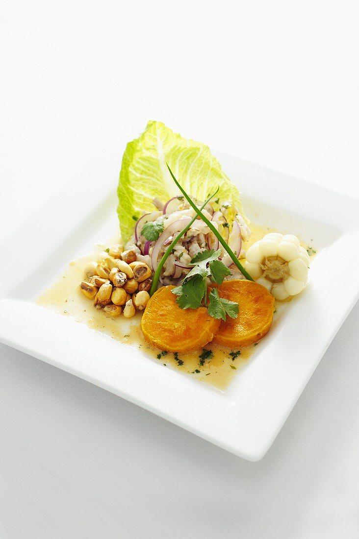 Tilapia Ceviche mit Andenmais, Süsskartoffel und Zitrus-Aji Amarillo-Sauce