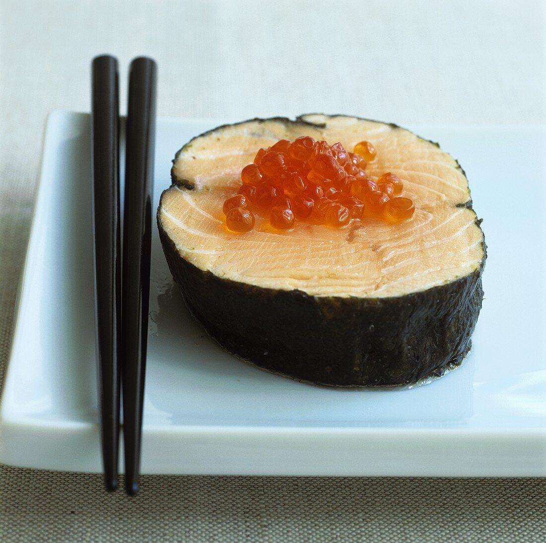 Salmon in nori leaf with salmon caviar