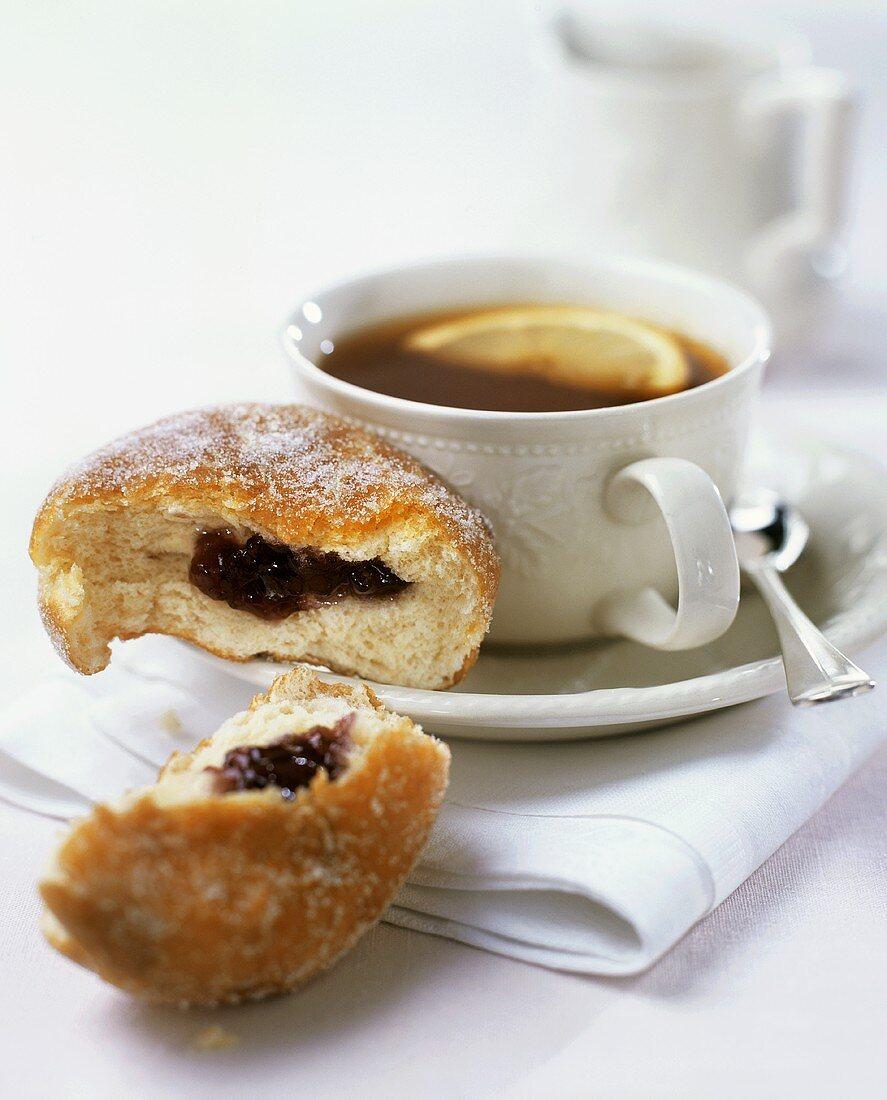 A cup of tea with doughnut