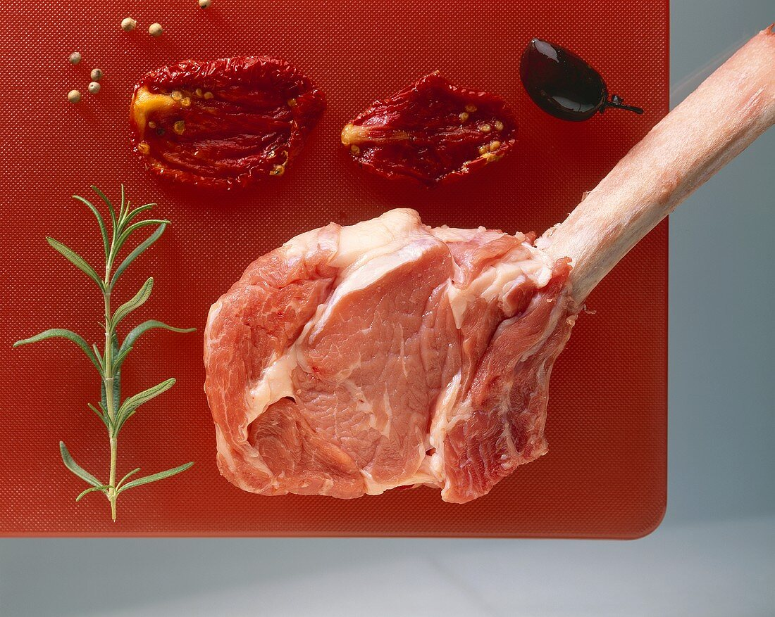 Beef chop with rosemary, dried tomatoes, olive