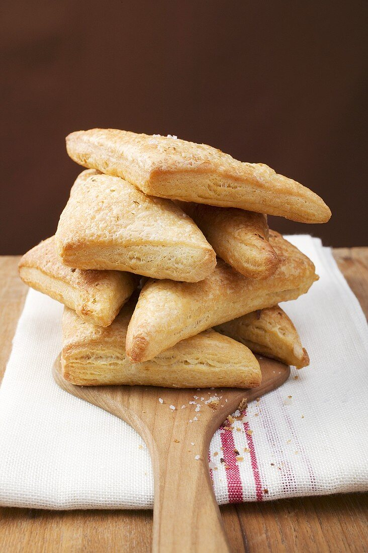 Triangular savoury puff pastry pasties, in a pile