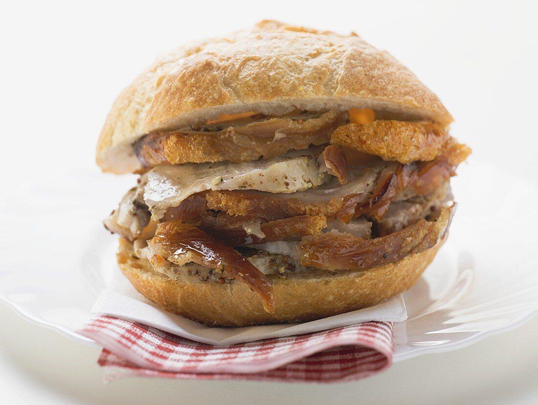 Roast pork in bread roll on napkin