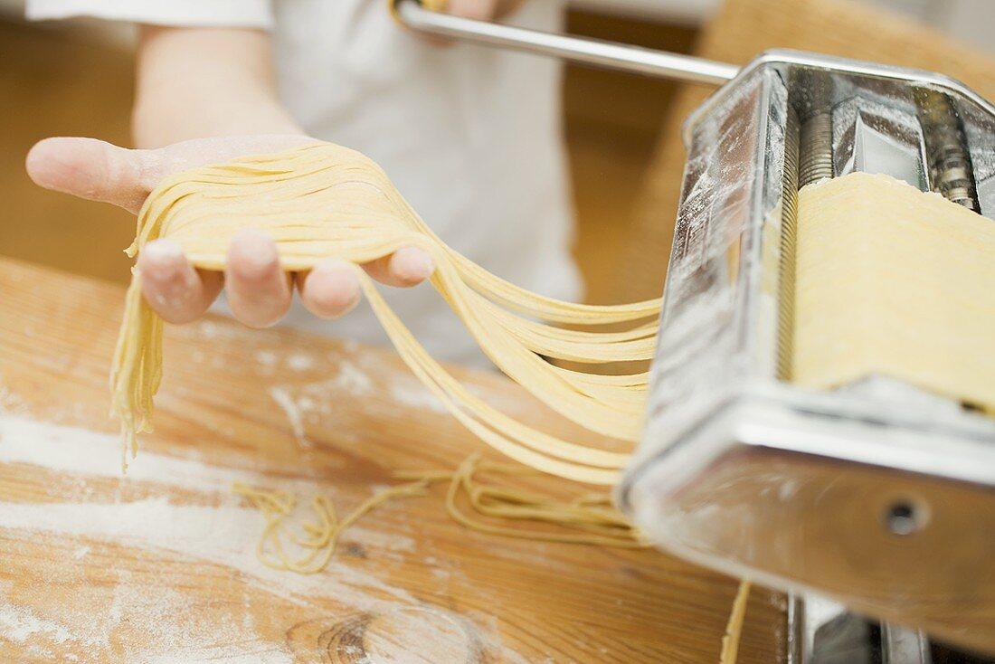 Making home-made ribbon pasta with pasta maker