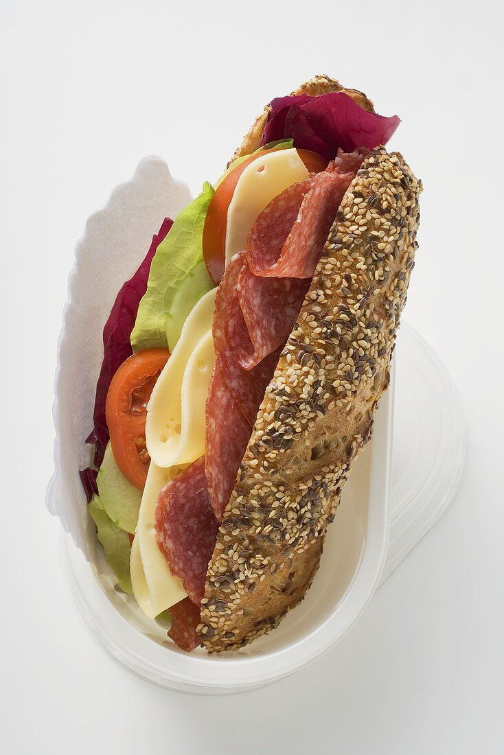 Granary roll filled with salami and cheese to take away