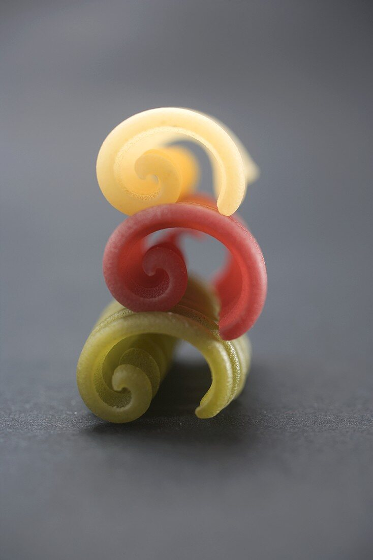 Three coloured riccioli, in a pile