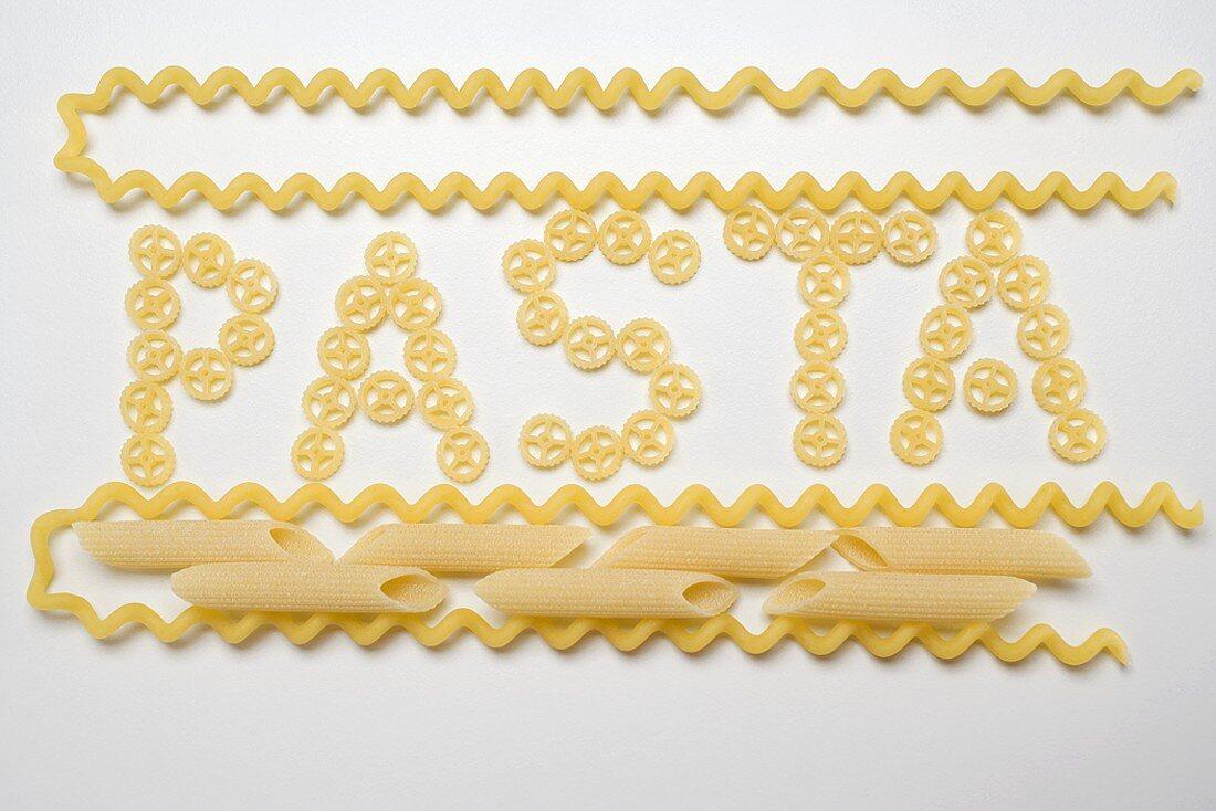 Wagon wheel pasta (the word 'Pasta'), fusilli lunghi, penne