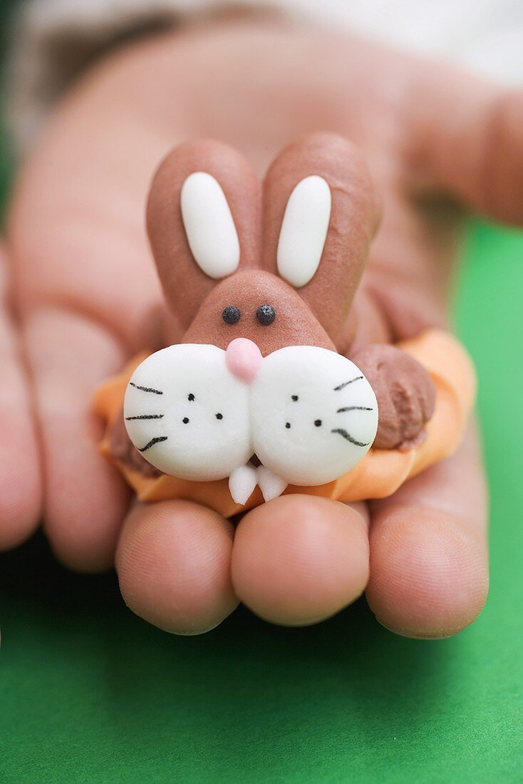 Child's hand holding marzipan Easter Bunny