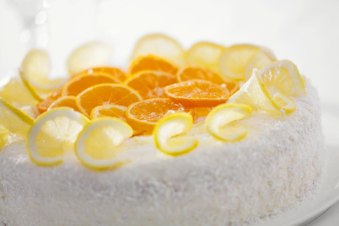 Orange and lemon gateau with grated coconut