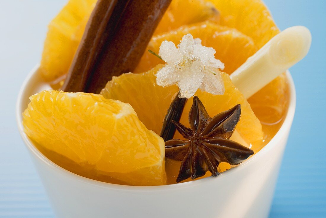 Orange slices with star anise, lemon grass & sugared flower