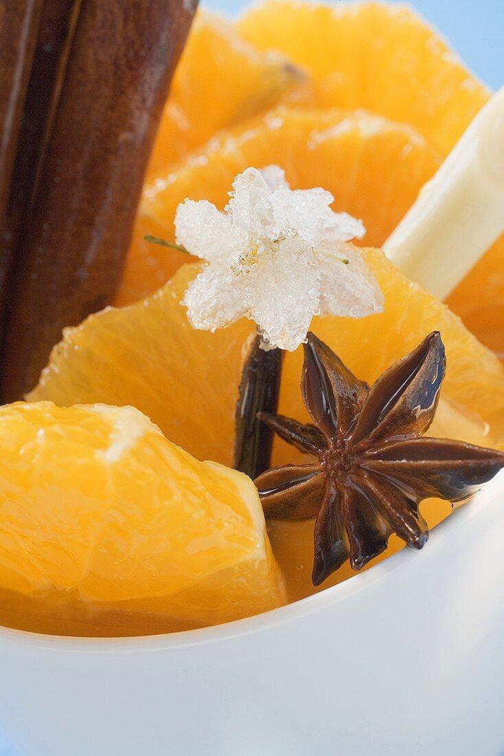 Orange slices with star anise, lemon grass & sugared flower