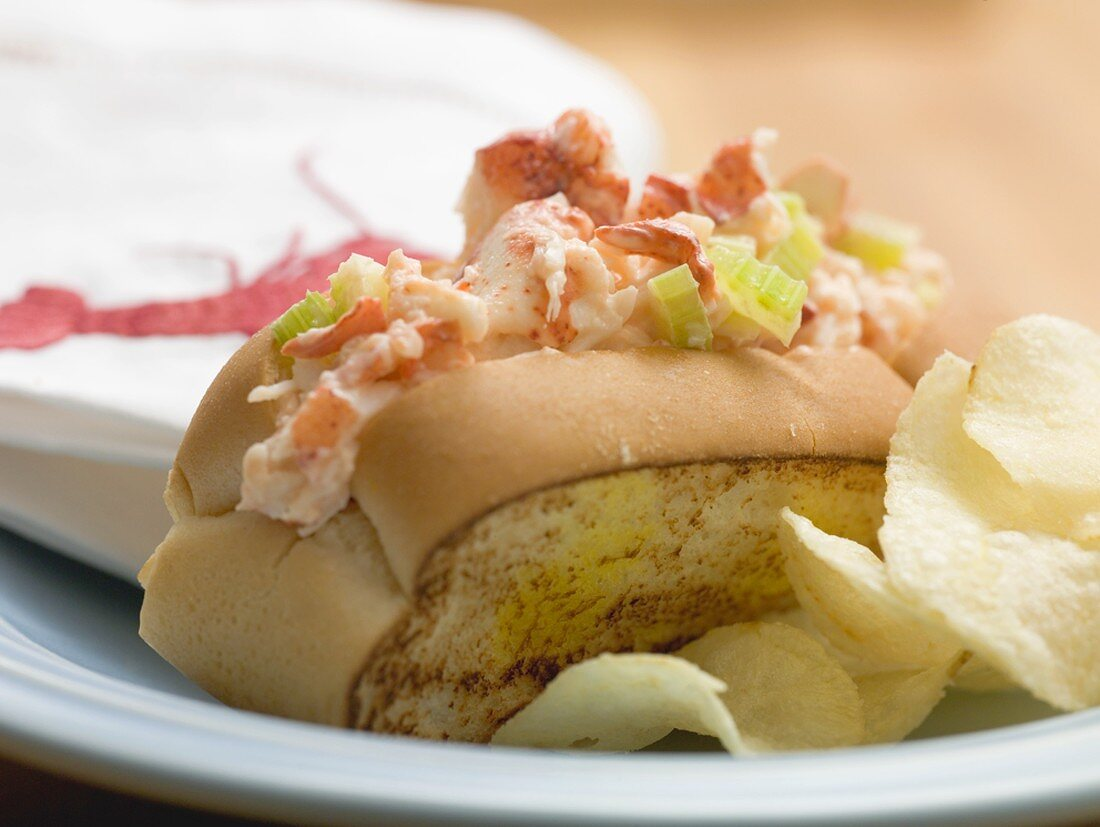Bread roll filled with lobster salad, crisps