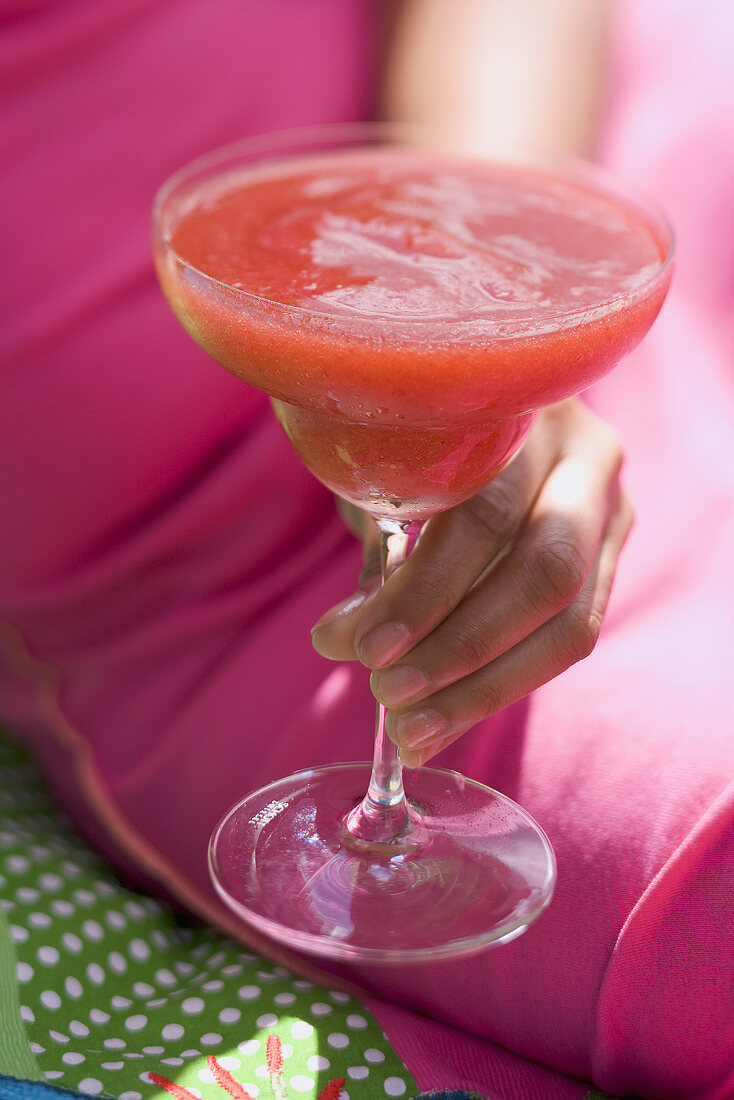 Woman holding fruity strawberry drink