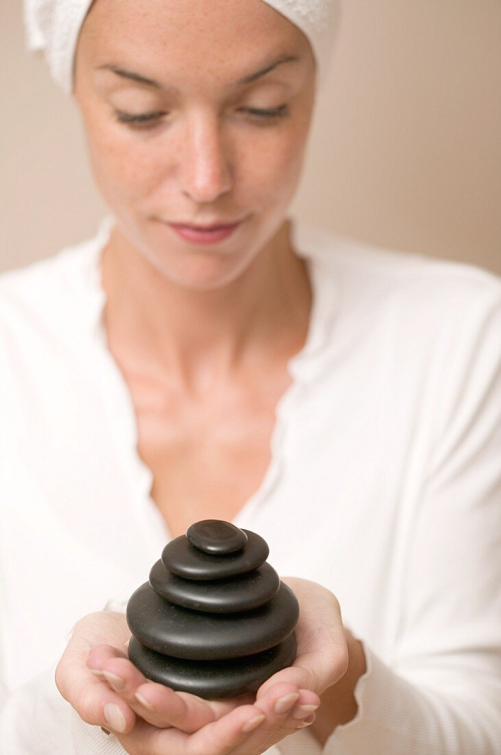 Woman holding stones for LaStone therapy