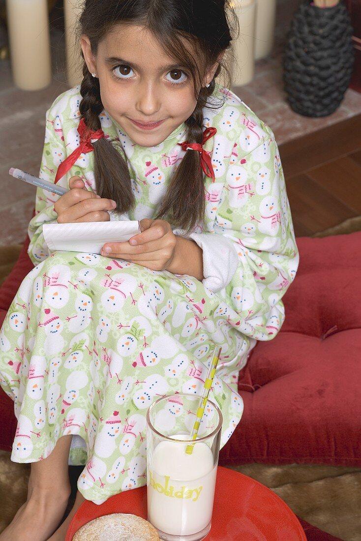 Girl writing her Christmas wish list