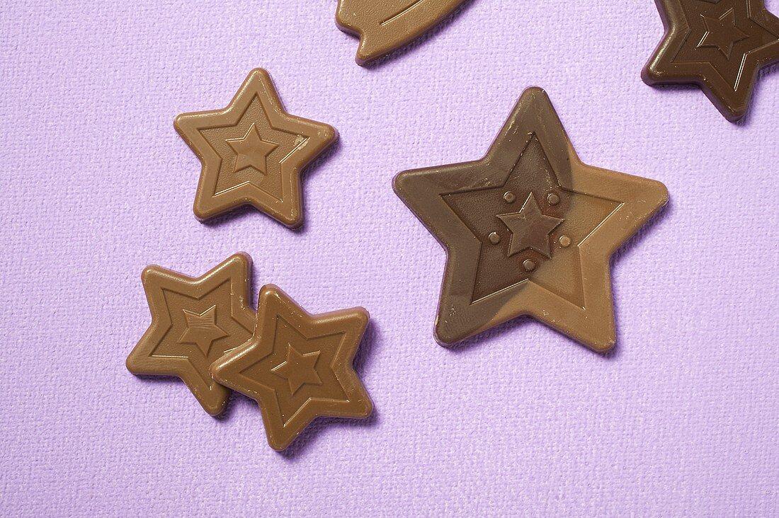 Chocolate stars on purple background