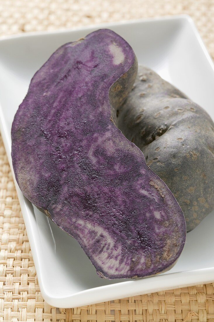 Truffle potato, halved, in white dish