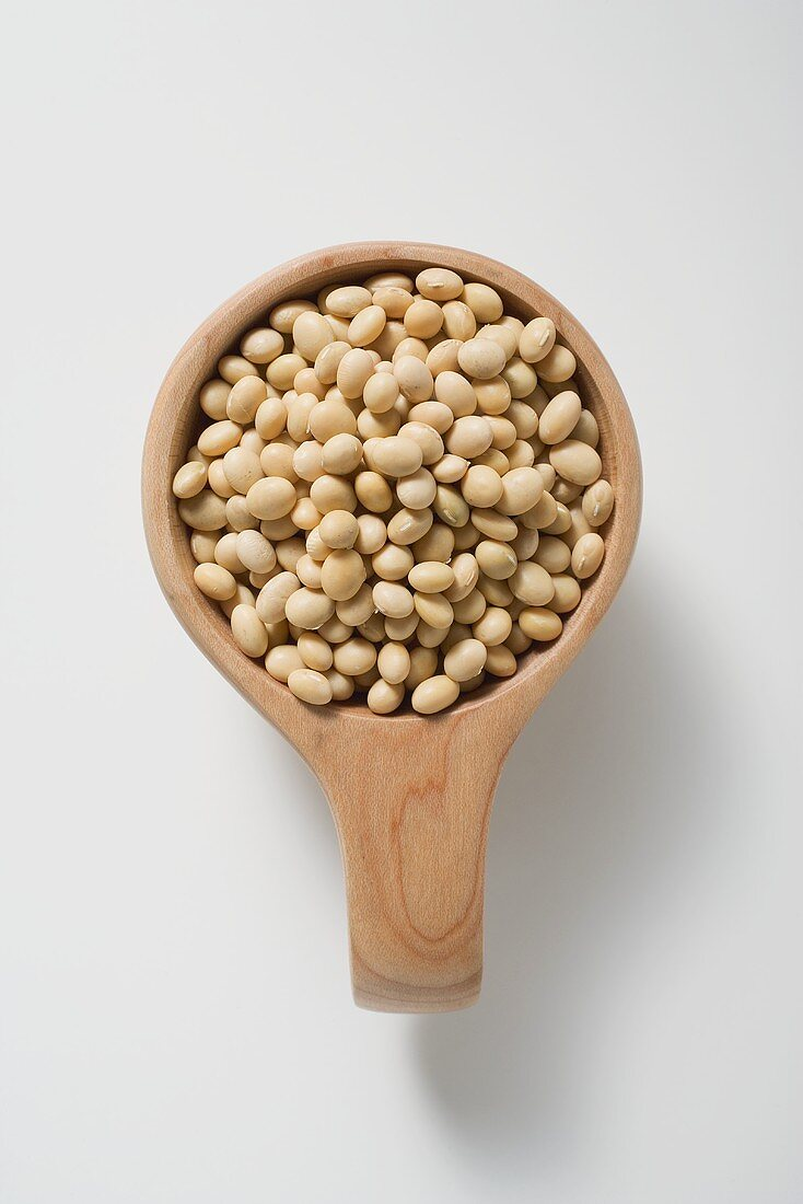 Soya beans in a small wooden bowl
