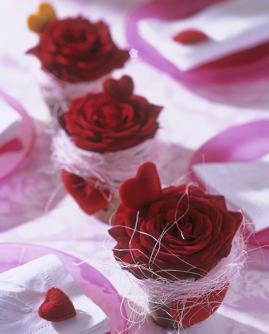 Red roses and hearts in terracotta pots