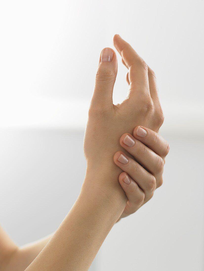 Woman putting on hand cream