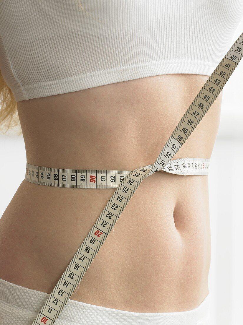 Tape measure around someone's waist