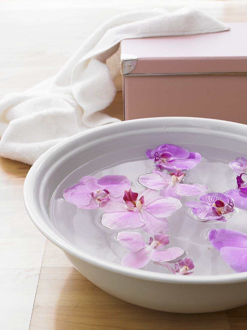 Foot bath with orchid flowers