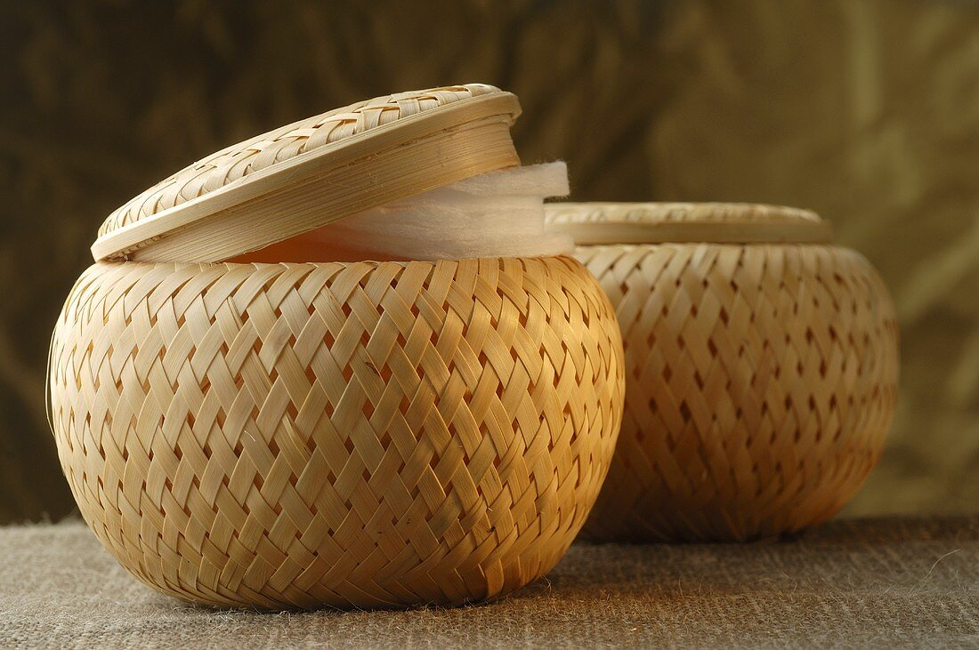 Woven baskets containing cosmetic items