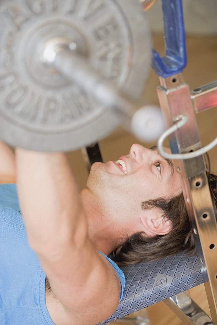 Man working out on weight bench