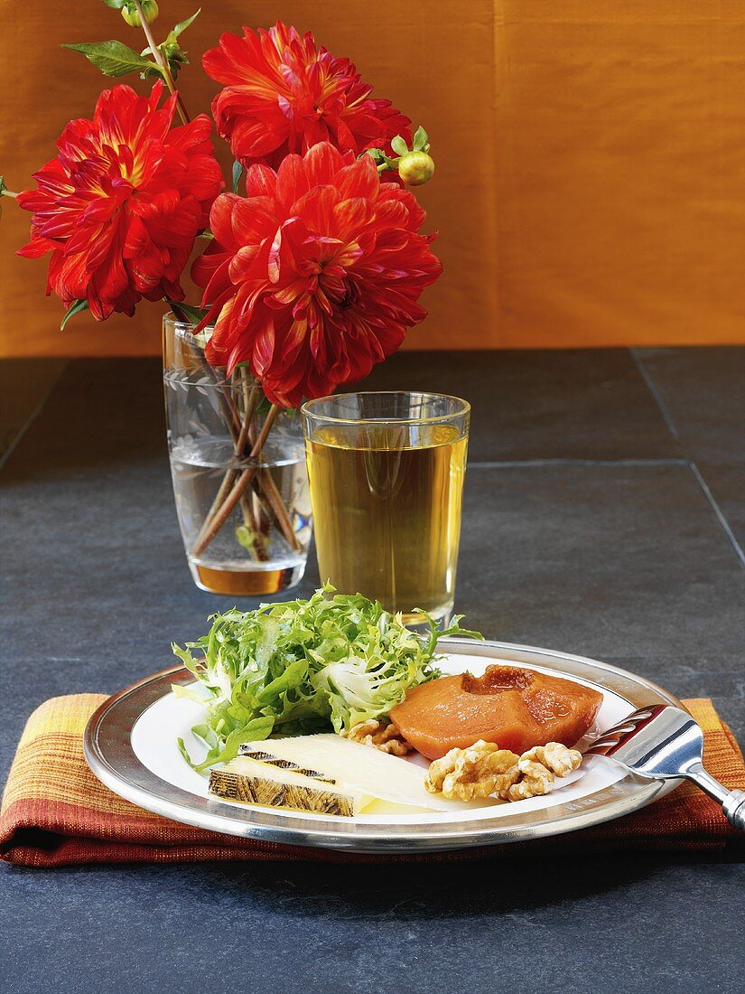 Appetiser plate: quince, cheese, walnuts and salad