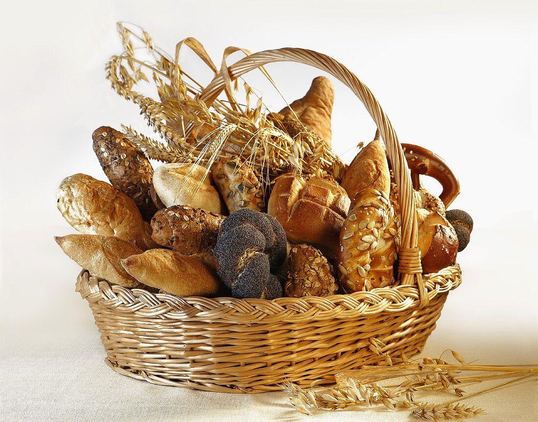 Assorted bread rolls, breads & cereal ears in bread basket