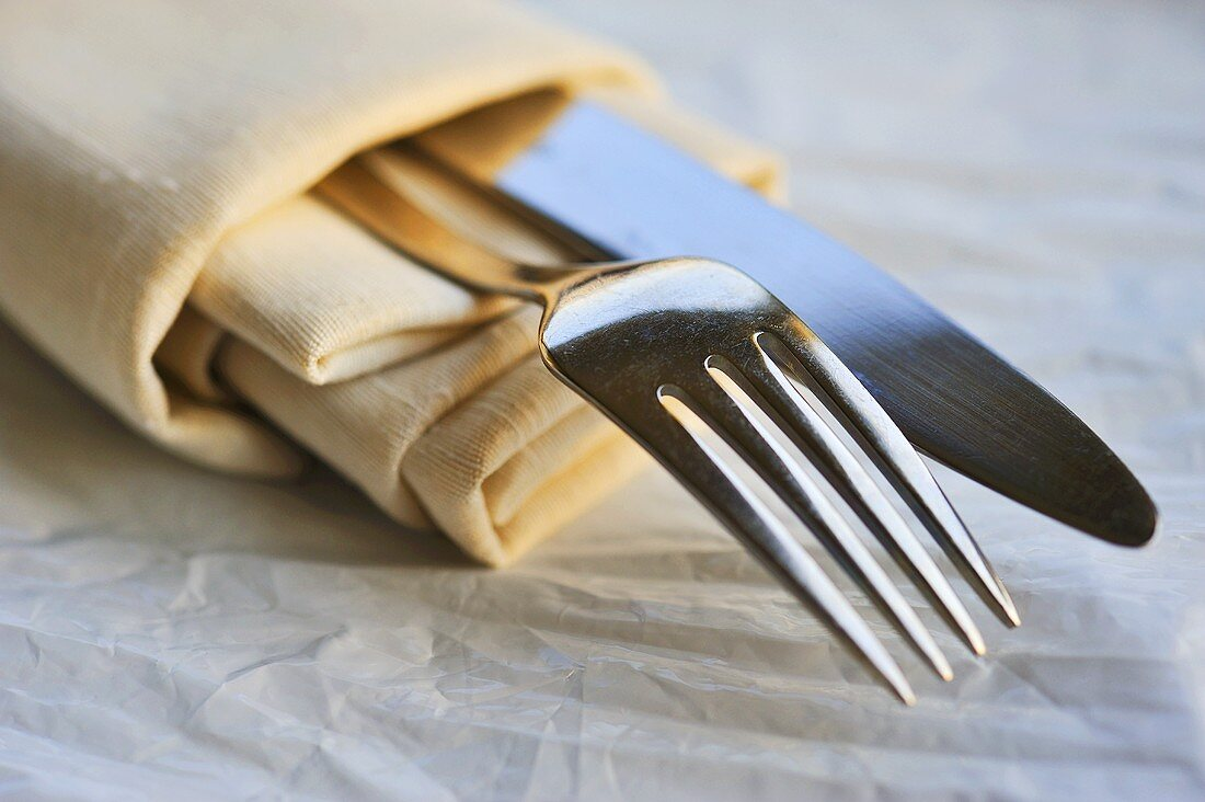 Fabric serviette with a knife and fork