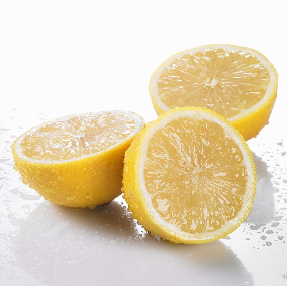 Three freshly washed lemon halves