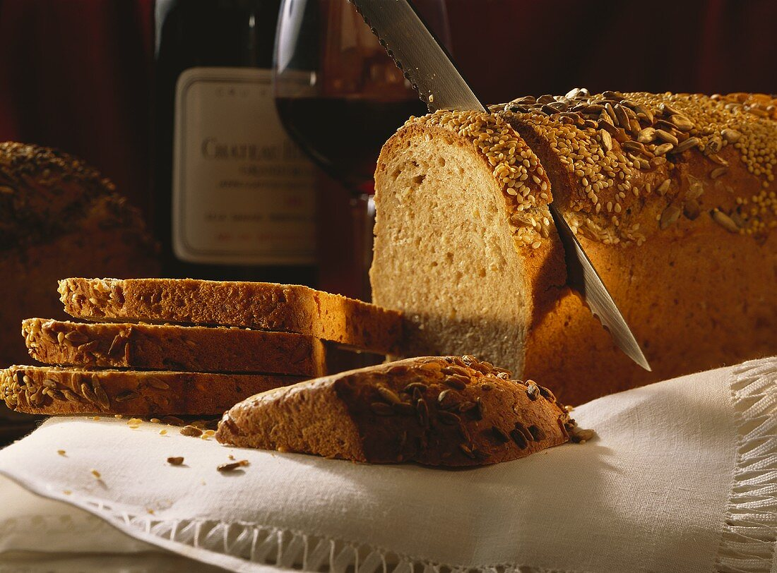 Slicing a Loaf of Homemade Whole Grain Bread