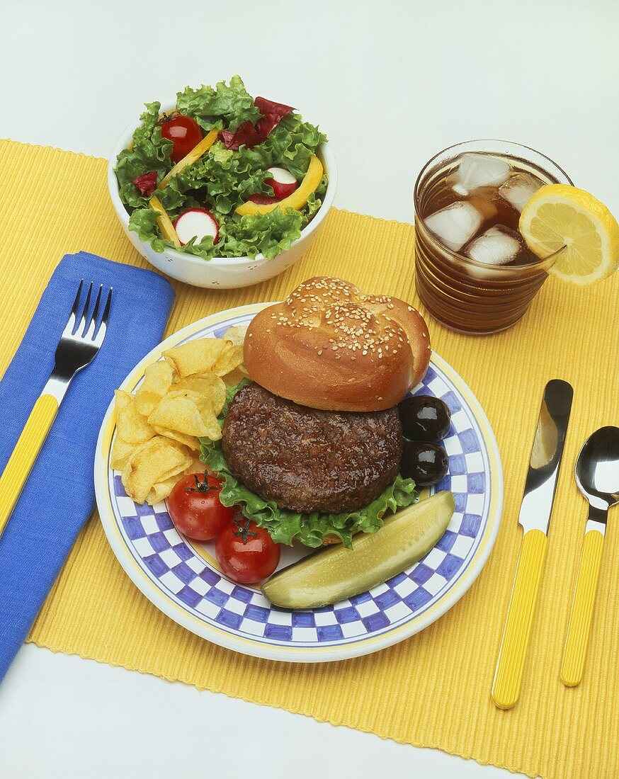 Hamburger with Pickle and Chips; Side Salad and Iced Tea