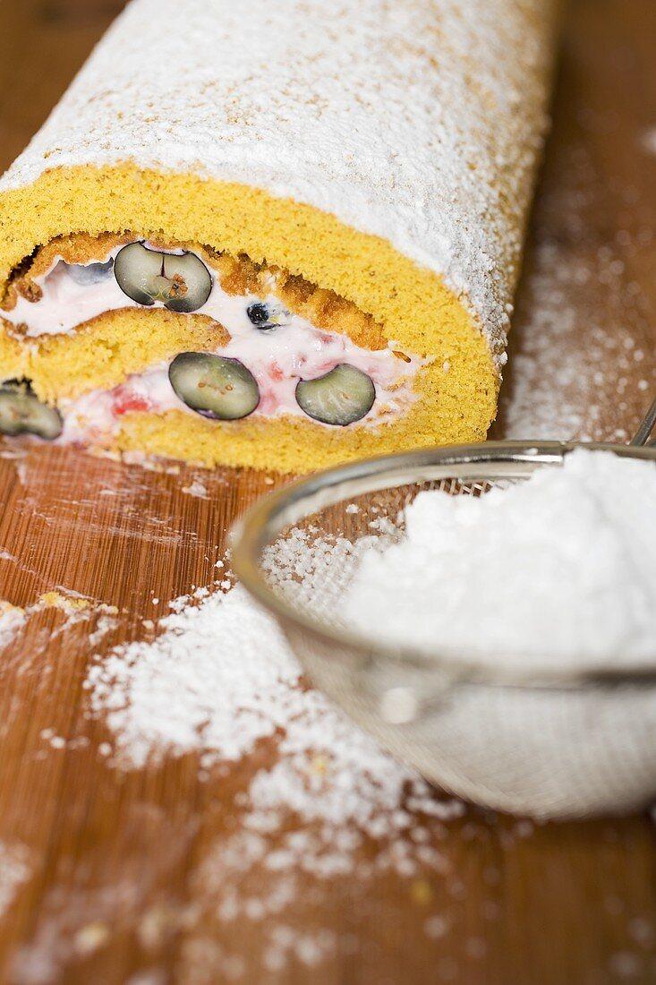 Sponge roulade with berry & quark filling, a slice taken