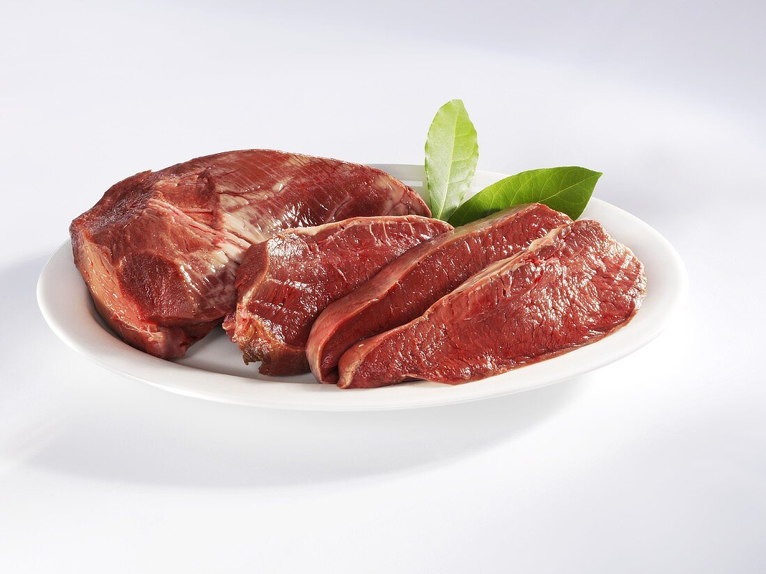A beef heart, partly sliced