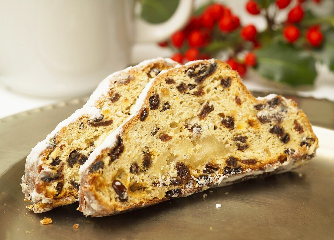 Two slices of stollen on a silver platter