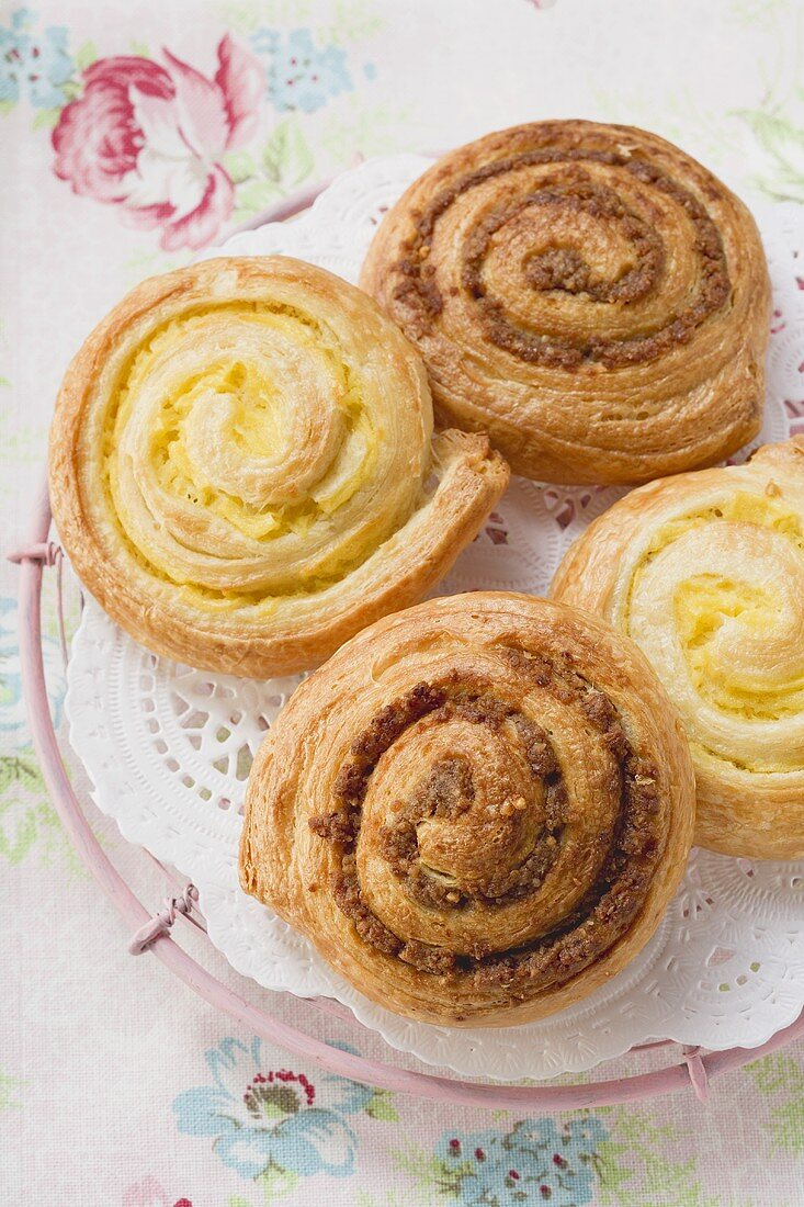 Danish pastry snails with nut and custard fillings