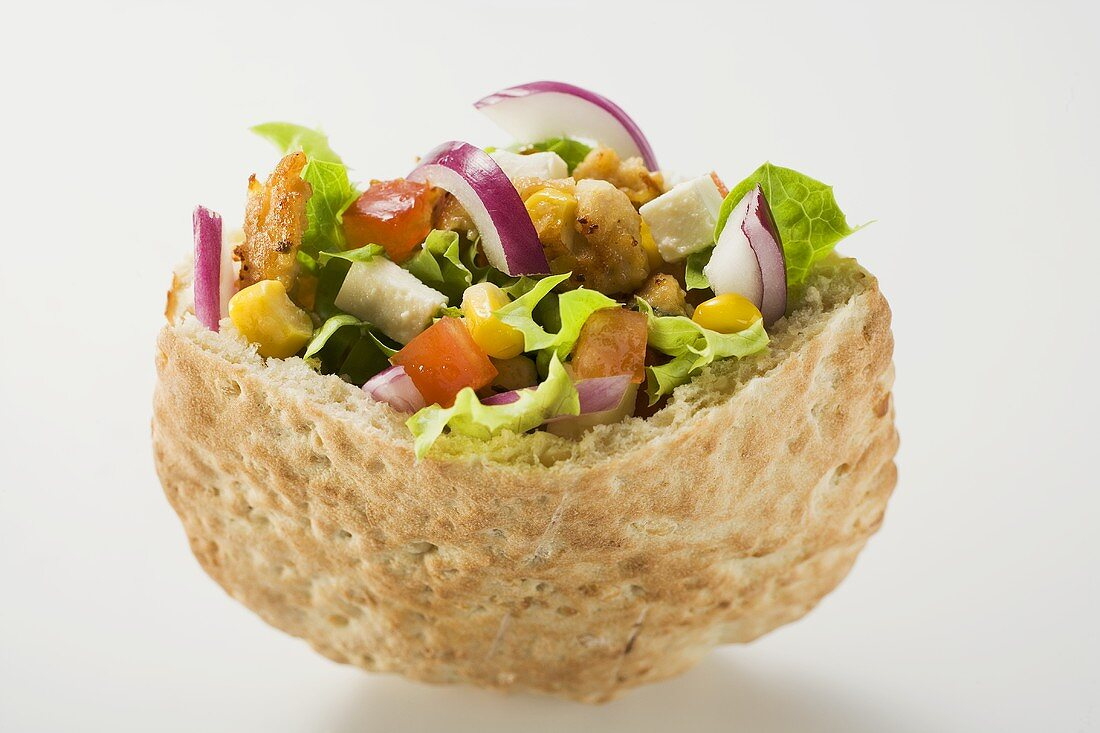 Pita bread filled with vegetables and roast turkey breast