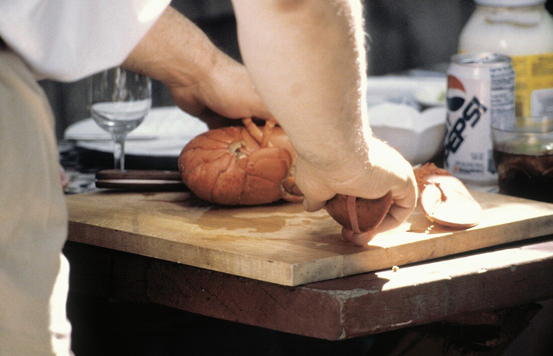 Man Cutting a Boiled Lobster